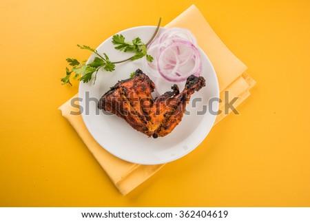 tandoori chicken leg, Tandoori Chicken , Indian spicy food, Delicious Tandoori chicken leg piece with Salad, India - stock photo