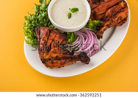 tandoori chicken legs, Tandoori Chicken , Indian spicy food, Delicious Tandoori chicken leg pieces with Salad, India