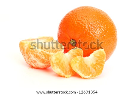 Tangerine and segments of a tangerine - stock photo