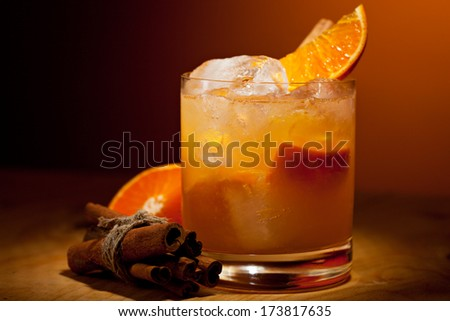 Tangerine Cocktail - Vodka, Tangerine, Lime Juice and Cinnamon Syrup - stock photo