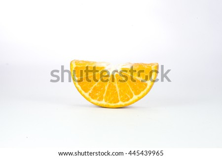 Tangerine cut into pieces - stock photo