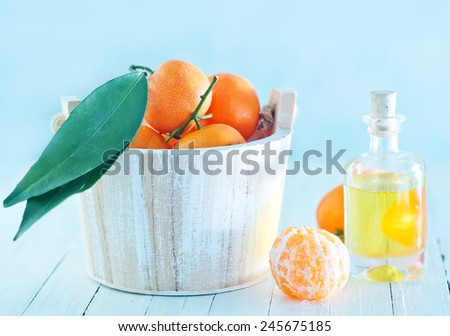 Tangerine essential oil on the white table - stock photo
