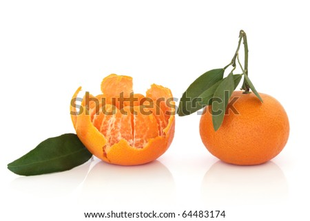 Tangerine fruit whole and peeled with leaf sprig isolated over white background.