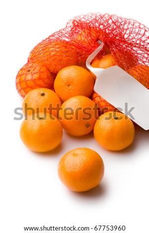 Tangerine in net isolated on white - stock photo