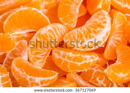 Tangerine segments, orange background texture - stock photo