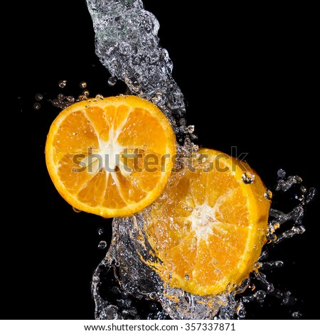 tangerine slices with stopped motion water - stock photo