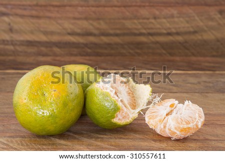 tangerine tasty tropical fruit on wooden background
