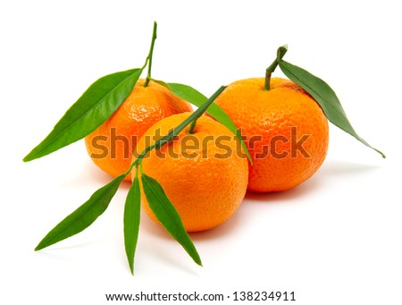 tangerine with leaf - stock photo