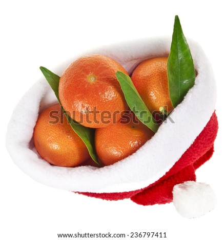 tangerines fruits in a christmas hat isolated over a white - stock photo