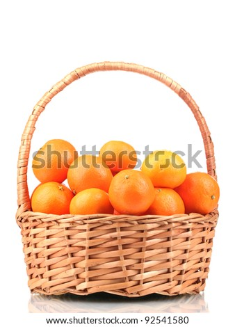tangerines in a beautiful basket isolated on white