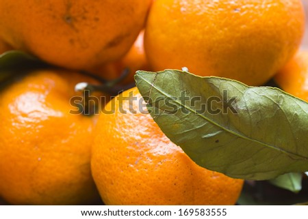Tangerines on a table wait when them will eat