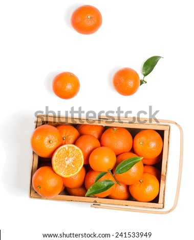 tangerines with green  leaves in wooden box isolated on white, top view,  isolated on a white - stock photo