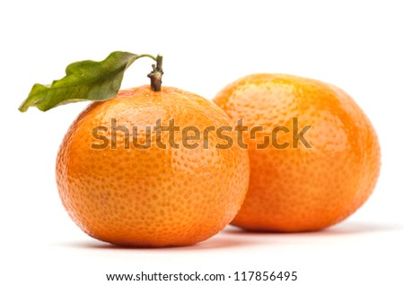 tangerines with leave isolated on white - stock photo
