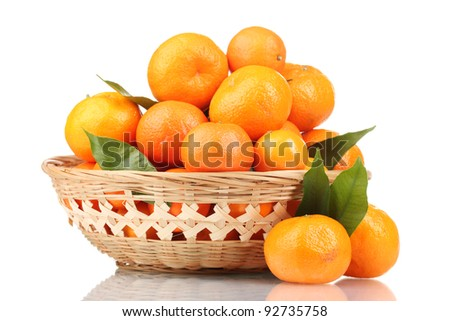 tangerines with leaves in a beautiful basket isolated on white