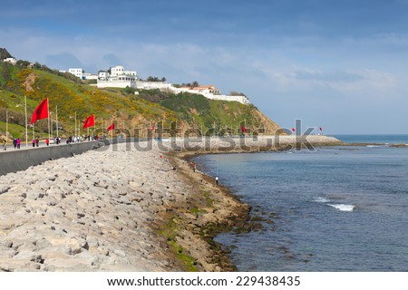 Tangier, Morocco - March 22, 2014: Coastal street panorama with flags, Tangier, Morocco - stock photo