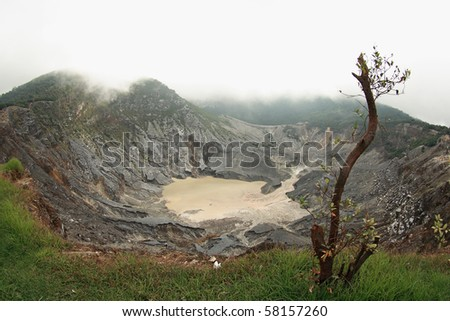 Tangkuban Parahu in local Sundanese dialect, is an active volcano 30 km north of the city of Bandung, Indonesia. This stratovolcano is last erupted in 1983. - stock photo