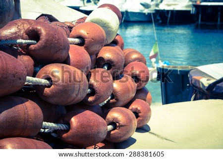 tangle of fishing nets with big Cork floats - stock photo