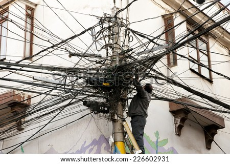 Tangled Electric Cables - stock photo