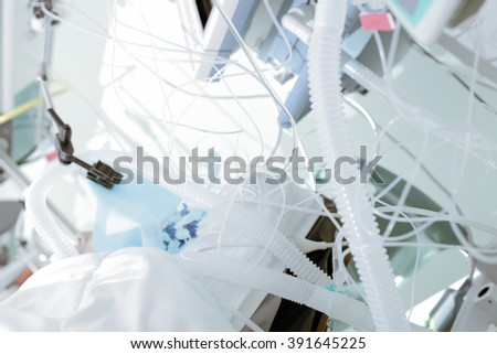 Tangled tube of medical equipment in the patient's room - stock photo