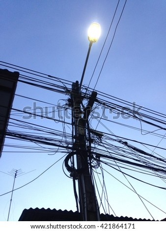 Tangled wired. Electric pylon.