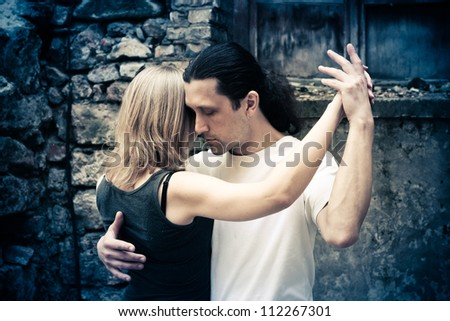 tango dancers on the street - stock photo
