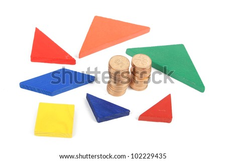 Tangram and coin - stock photo