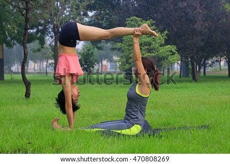 Tangshan - August 17: women doing yoga exercise in the park, August 17, 2016, tangshan city, hebei province, China
