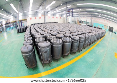 TANGSHAN, CHINA - DECEMBER 22: Pressure tank put in a warehouse workshop, in a solar equipment production workshop on december 22, 2013, tangshan, china.