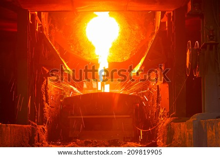 TANGSHAN - JUNE 18: converter dumping steel slag in iron and steel co., on June 18, 2014, Tangshan city, Hebei Province, China  - stock photo