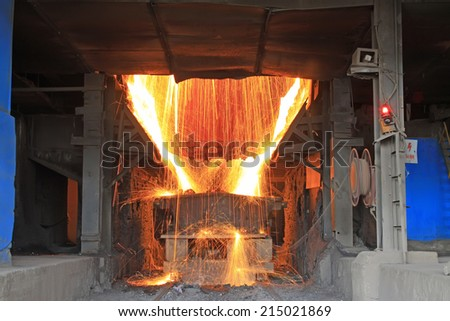 TANGSHAN - JUNE 20: converter dumping steel slag in iron and steel co., on June 20, 2014, Tangshan city, Hebei Province, China  - stock photo