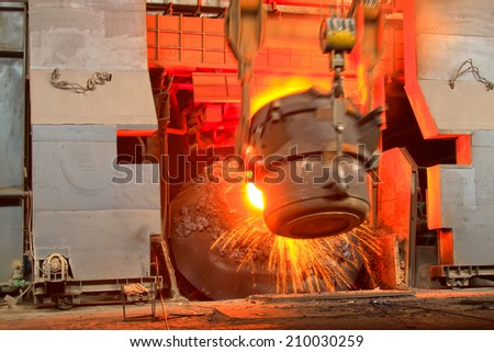 TANGSHAN - JUNE 18: converter filling scrap iron and steel, in a iron and steel co., on June 18, 2014, Tangshan city, Hebei Province, China  - stock photo