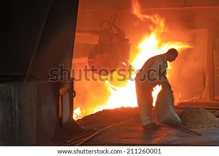 TANGSHAN - JUNE 19: iron works blast furnace operating workers, on June 19, 2014, Tangshan city, Hebei Province, China