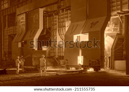 TANGSHAN - JUNE 19: steel mills converter workers tense work, on June 19, 2014, Tangshan city, Hebei Province, China  - stock photo