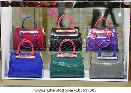 TANGSHAN - NOVEMBER 18: Ms color bag were put on the shelf in a store, on November 18, 2013, tangshan city, hebei province, China.