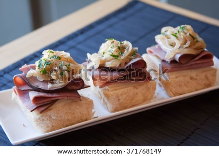 Tangy horseradish roast beef sliders on Hawaiian sweet rolls - stock photo