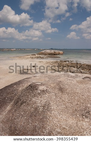 Tanjung Tinggi beach, Belitung island, Bangka-Belitung, Indonesia - August 30, 2007 : View from the other side of Tanjung Tinggi beach, with rocks in the foreground
