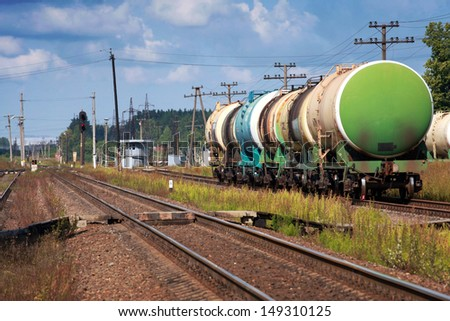 Tank cars stand on cargo railway station - stock photo