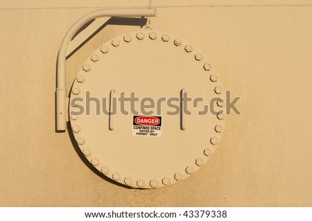 Tank confined space entry with warning sign - stock photo