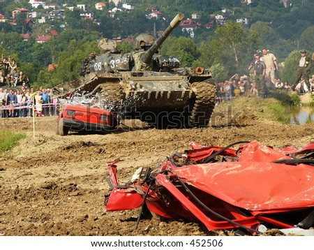 Tank crash (Operation South 2005 in Bielsko-Biala, Poland). Old cars crashed by tank. - stock photo
