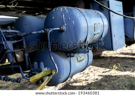 Tank of a large truck full with oil - stock photo