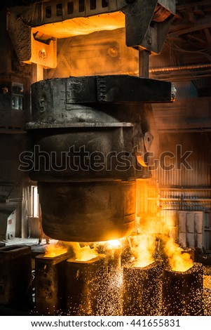 Tank pours the liquid steel in the molds - stock photo