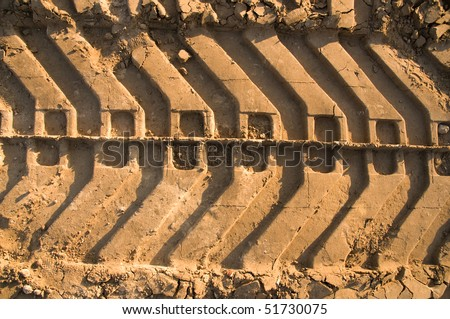 Tank tracks in the sand - stock photo