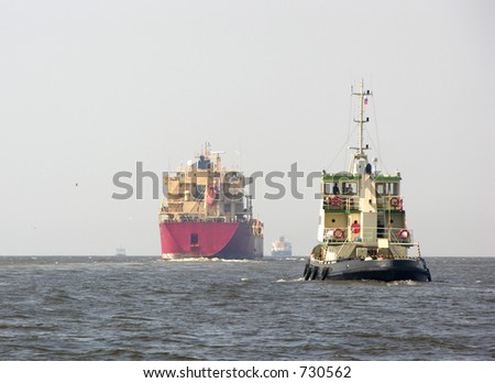 tanker and tugboat - stock photo
