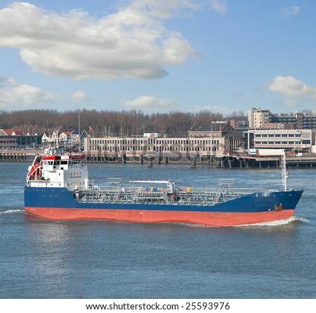 Tanker coming into the river - stock photo