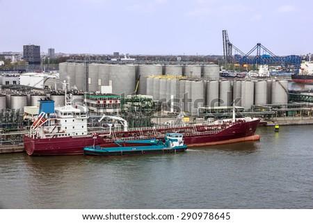 Tanker port terminal and cargo ship, Rotterdam, Netherlands - stock photo
