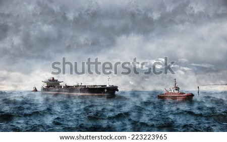 Tanker ship at sea during a storm. - stock photo