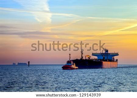 Tanker ship at sunrise. - stock photo