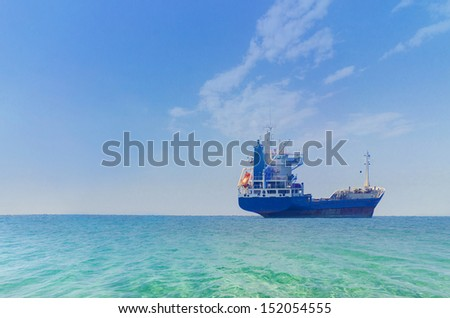 Tanker ship at sunrise.tanker at open sea horizon - stock photo