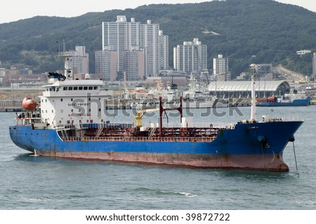Tanker - ship designed for transporting grude oil with anchor - stock photo