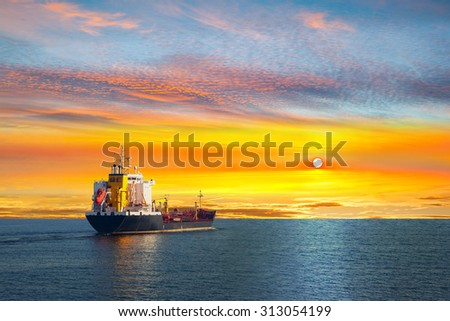 Tanker ship on calm sea in the morning. - stock photo
